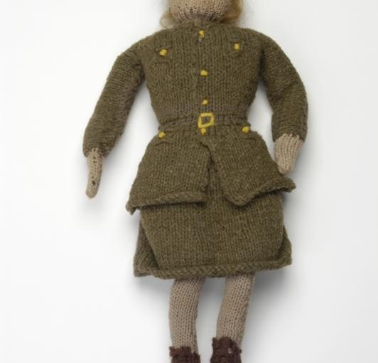 Knitted ATS Doll (EPH 2877) Doll and knitting patterns. Copyright: © IWM. Original Source: http://www.iwm.org.uk/collections/item/object/30084130