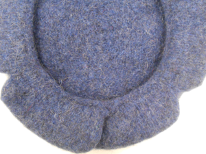 Detail of a knitted sixteenth century cap as reproduced by Kirstie Buckland.