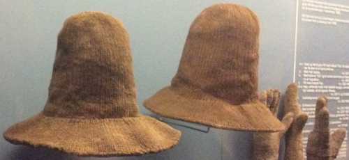 Early seventeenth century knitted hats and gloves on display in the National Museum in Copenhagen. Photo by Paula Hohti