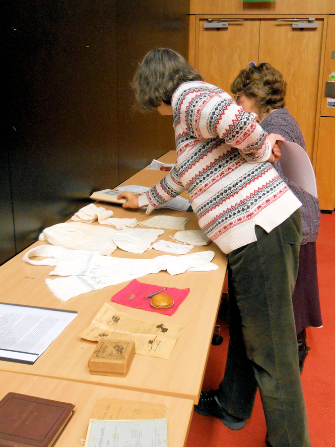 Members of KHF and conference delegates looking at items of knitting history
