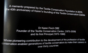 Dr Karen Finch OBE. Detail of a Textile Conservation Centre (TCC) 40th anniversary tribute volume. Photo by Kirstie Buckland.