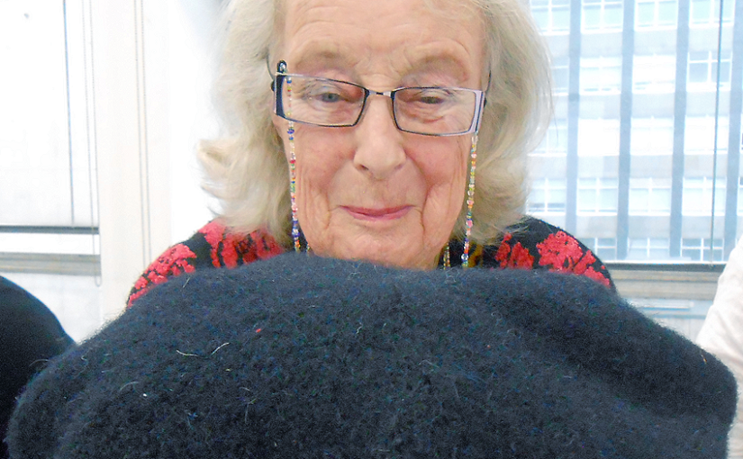 Kirstie Buckland, Honorary President of Knitting History Forum, with one of her reproduction knitted sixteenth century caps, at the KHF Conference in 2017 Banner