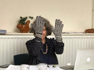 Knitting History Forum/Early Knitting History Group Reconstruction Knitted Sanquhar Gloves courtesy of Kirstie Buckland, being worn by Chair Prof. Sandy Black at the KHF AGM in Leiden 2019. PLEASE DO NOT USE IMAGE WITHOUT PERMISSION