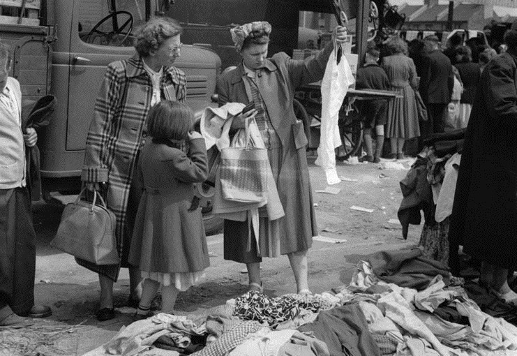 Photo by Bob Collins 'Women examining second-hand clothes at a street market in Mile End' circa 1948