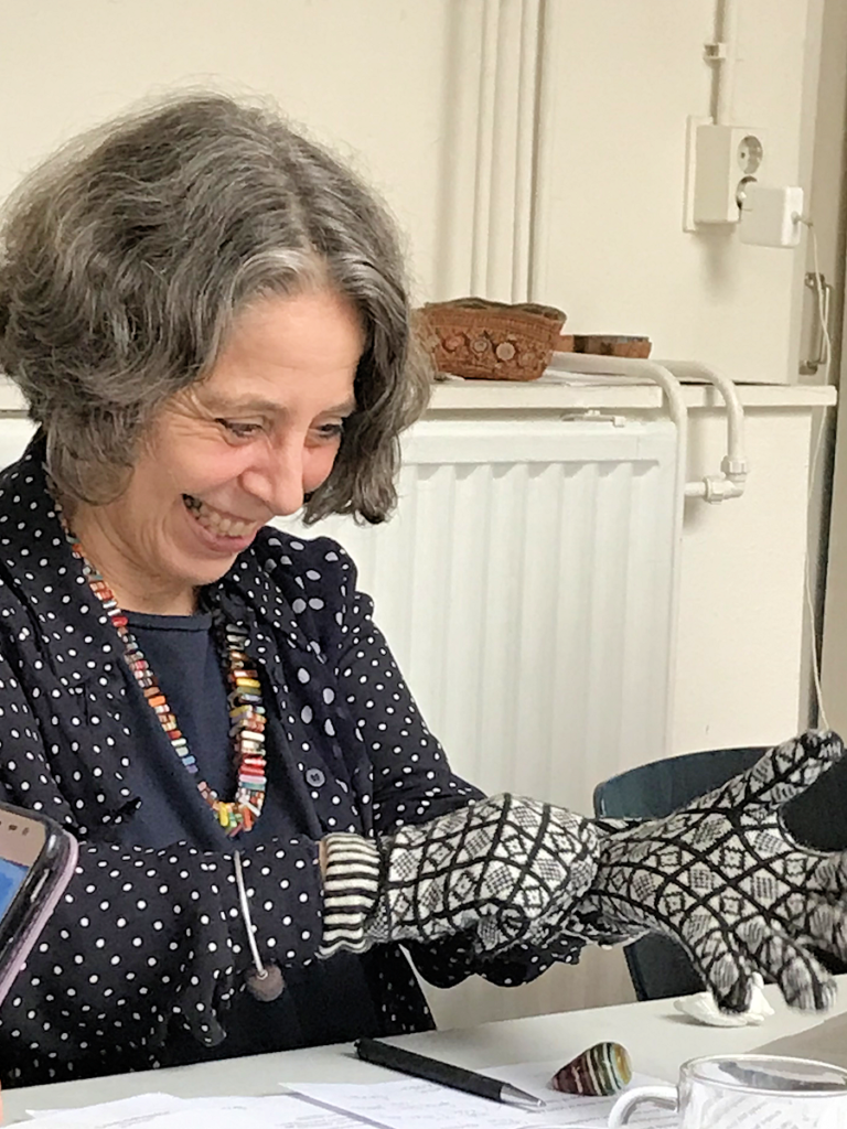 Knitting History Forum TRC Leiden Conference 2019 – KHF Chair Prof Sandy Black models the EKHG Sanquhar gloves donated by Kirstie Buckland, see notes in 2019 AGM minutes and subsequent post on website – image 2019 by Christine Carnie
