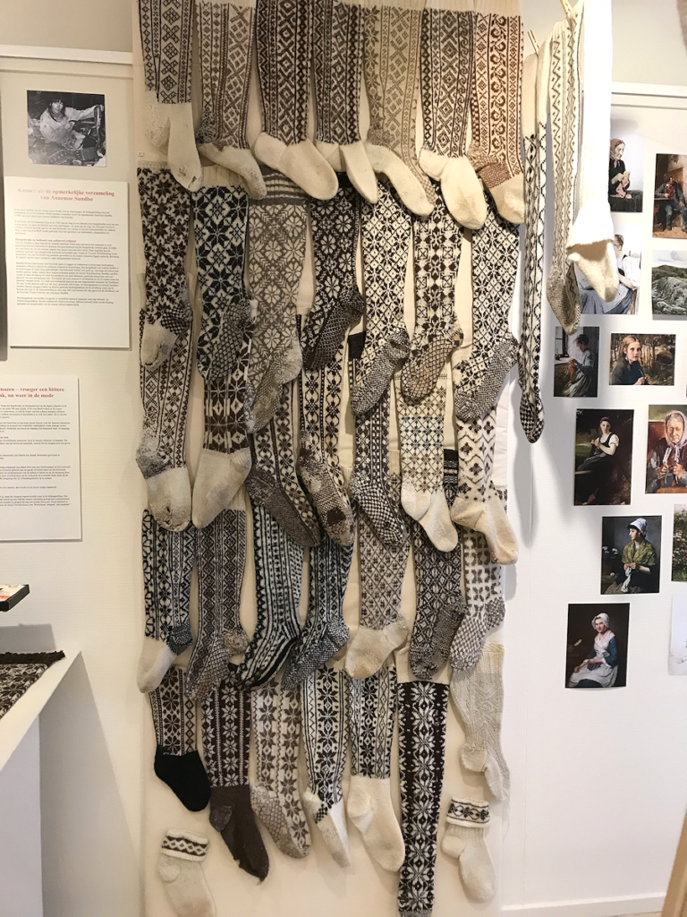 """Knitting History Forum TRC Leiden Conference 2019 – The """"stocking wall"""" Seeing all those different types of designs and patterns was incredibly inspiring, I came away from my visit wanting to knit all sorts of socks :-), exhibition at the TRC, visited on Sunday 3rd November – image 2019 by Christine Carnie"""