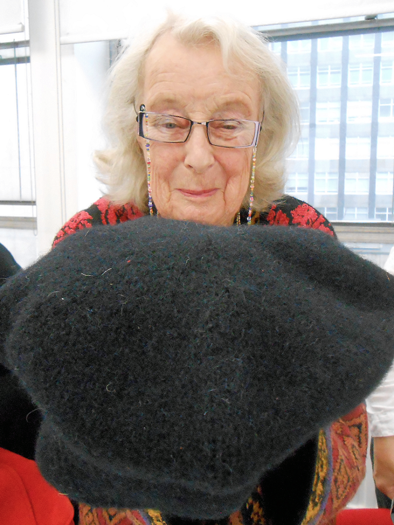 Kirstie Buckland, Honorary President of Knitting History Forum, with one of her reproduction knitted sixteenth century caps, at the KHF Conference in 2017